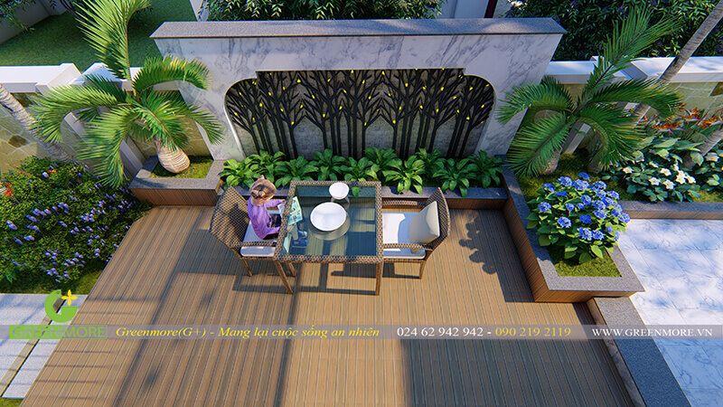Không gian bố trí của sân vườn bên hông nhà với điểm nhấn là bức tường ốp đá và hoa văn cắt CNC hiện đại, một bộ bàn ghế nhỏ là thích hợp cho chủ nhân ngôi nhà hưởng thụ không gian an lành vào buổi sáng sớm và chiều muộn.
